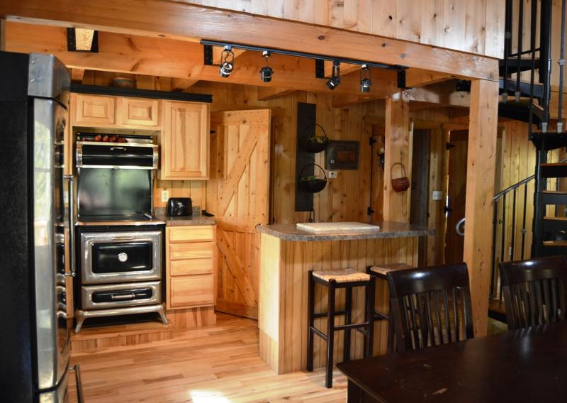 Fully equipped kitchen on first level.
