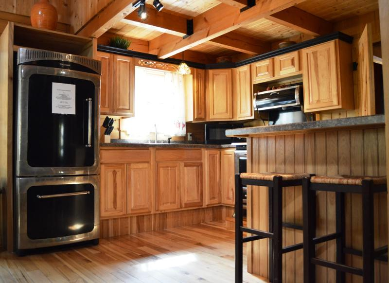 The first level kitchen features a bar with room for two.
