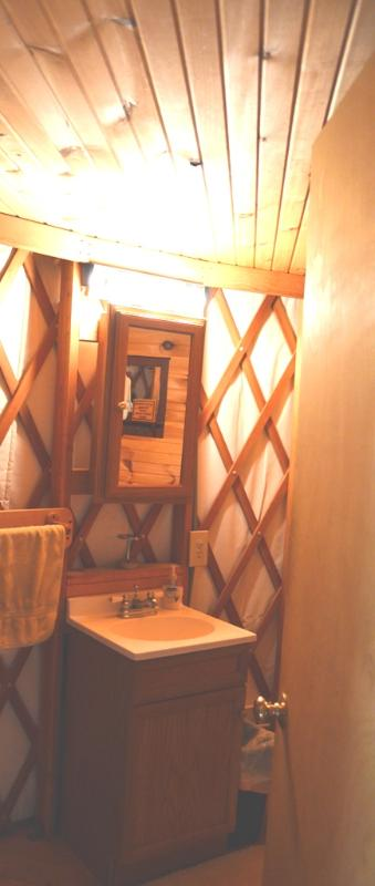The Yurt features a full bathroom, right off the sleeping area.