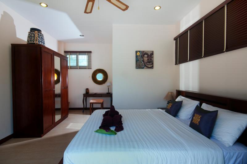 Bright and airy master bedroom wardrobe, desk, safe, hairdryer and fully air-conditioned.