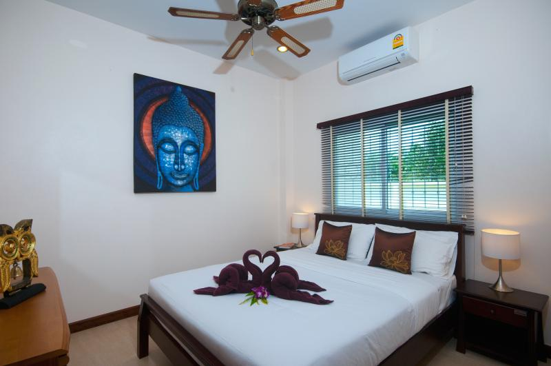 2nd bedroom with double bed, light and airy with air-conditioning. Great access to pool and garden.