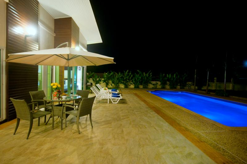 Bbq, dining table and chairs with sun loungers. This spacious villa for couple, friends and family.