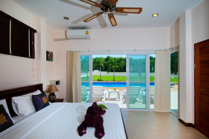 Master en-suite bedroom with direct access to the 11*4 metre swimming pool.