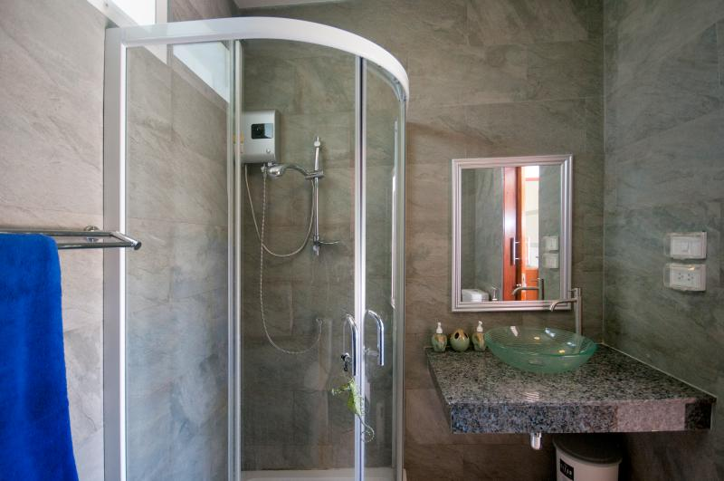 2nd shower room between the 2nd and 3rd bedrooms easily accessible to the swimming pool and garden.