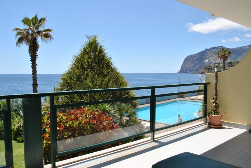 Private balcony over the gardens and with pool and sea view
