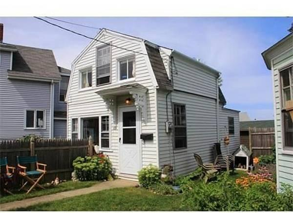 Cottage from the street. 50 yards from the docks on inner harbor