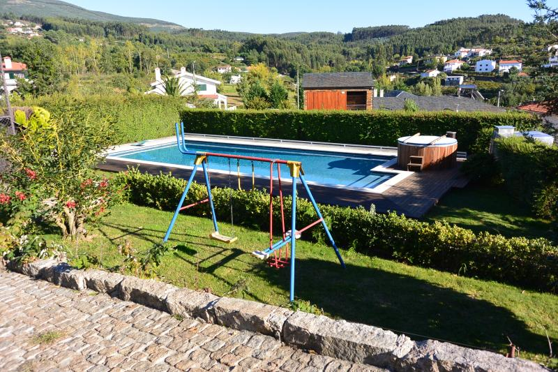 Children's playground, swimming pool and jacuzzi with the Casa do Lagar and bottom
