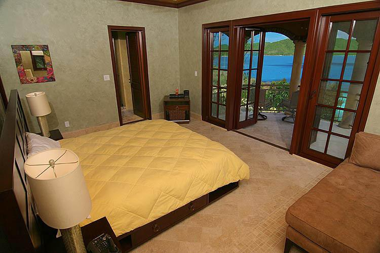 Villa Cinnamon Breeze Bedroom #2 (below the MBR) with king bed, love seat, & private balcony.