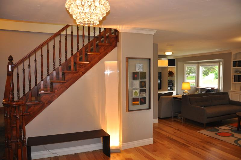 Front Entrance: Sitting bench and artwork frame solid wood staircase railing