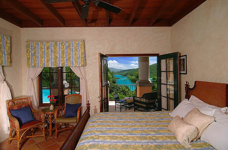 Bedroom 3, on the lower level of The Great House, opens to stately doric columns & a Caribbean view.