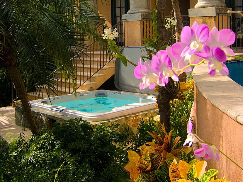 The Villa Coco de Mer poolside spa surrounded by tropical gardens
