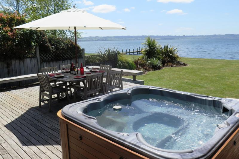 Private lakeside spa and BBQ setting