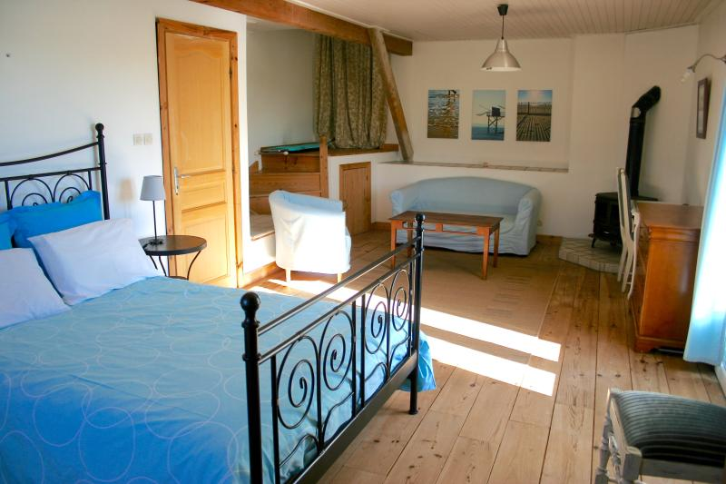 A first double bedroom with a fantastic view on the surrounding countryside