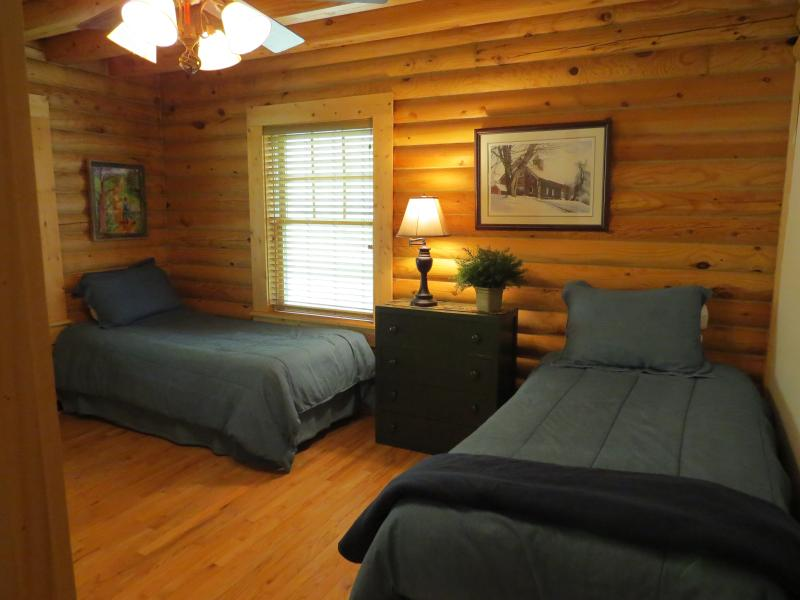 The main floor twin bedroom is perfect for more guests or for your children.