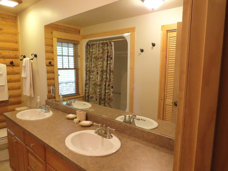 The main floor bathroom also has a large size washer and dryer.