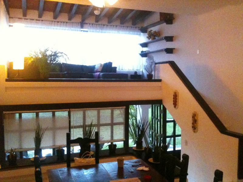 living room overlooking the gardens and swimming pools, dinning room overlooking the garden