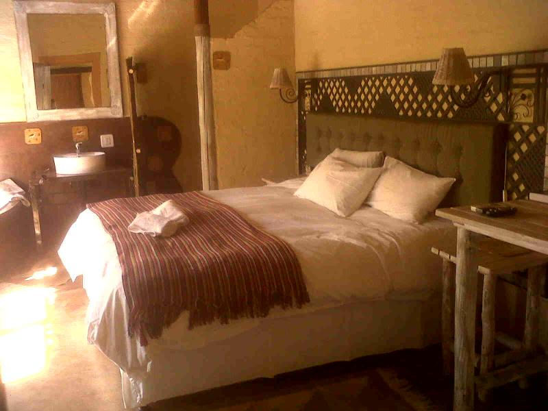 Spacious standard double room (one of 4 rooms under thatch roof to experience African Silhouette