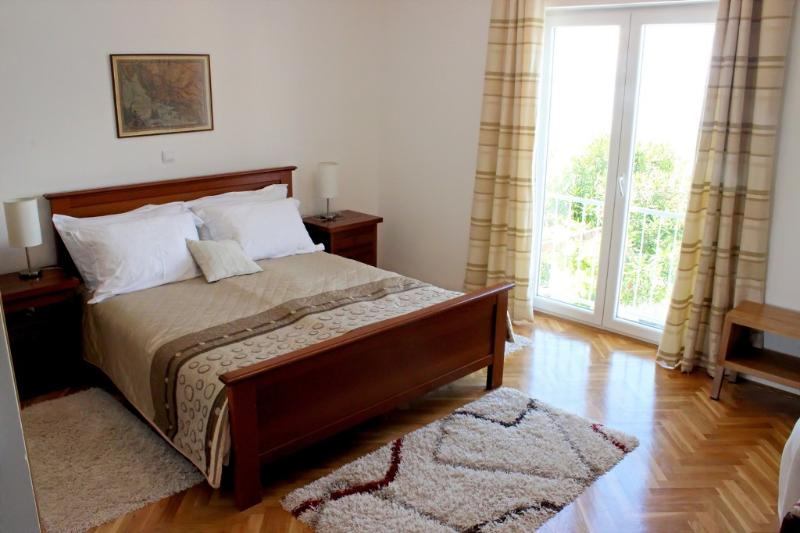 First floor double bedroom with sea view and extra single sofa bed on request