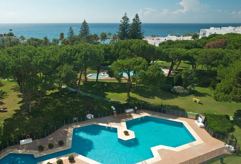 Partial aerial view of Club Playas Del Duque gardens and beach. The Ocean Club is on our beach.