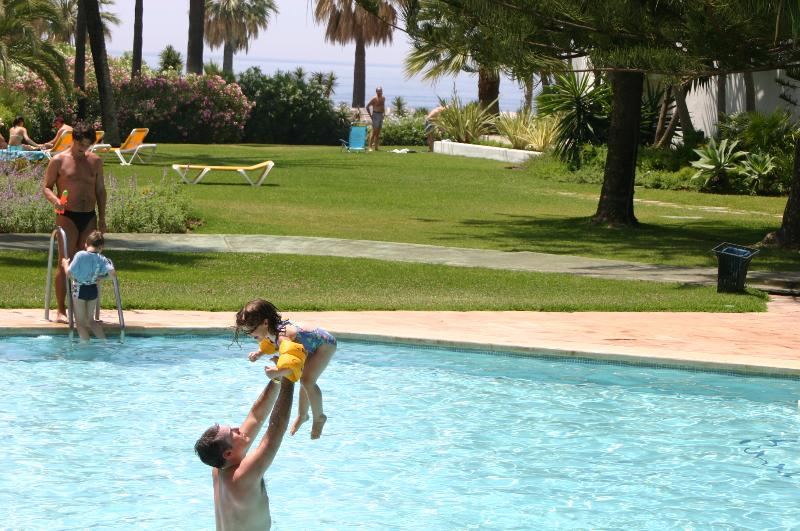 Family fun in the pool with the Mediterranean sea in the background