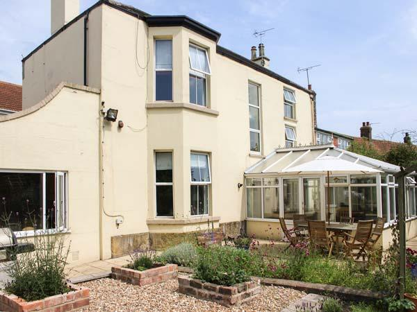 WALMSLEY HOUSE, pet friendly, character holiday cottage, with a garden in, vacation rental in Bridlington