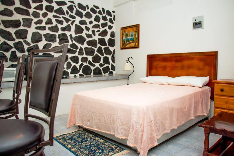 View of bed in studio