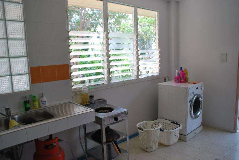 Laundry machine and thai kitchen in a separate house