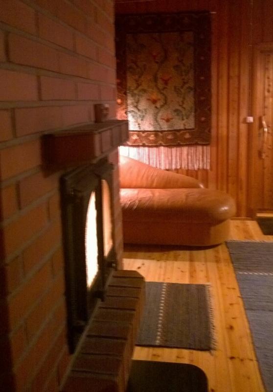 Salle de la cheminée, sauna au bord du lac