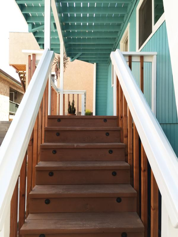 Up these stairs is the entrance to your getaway.
