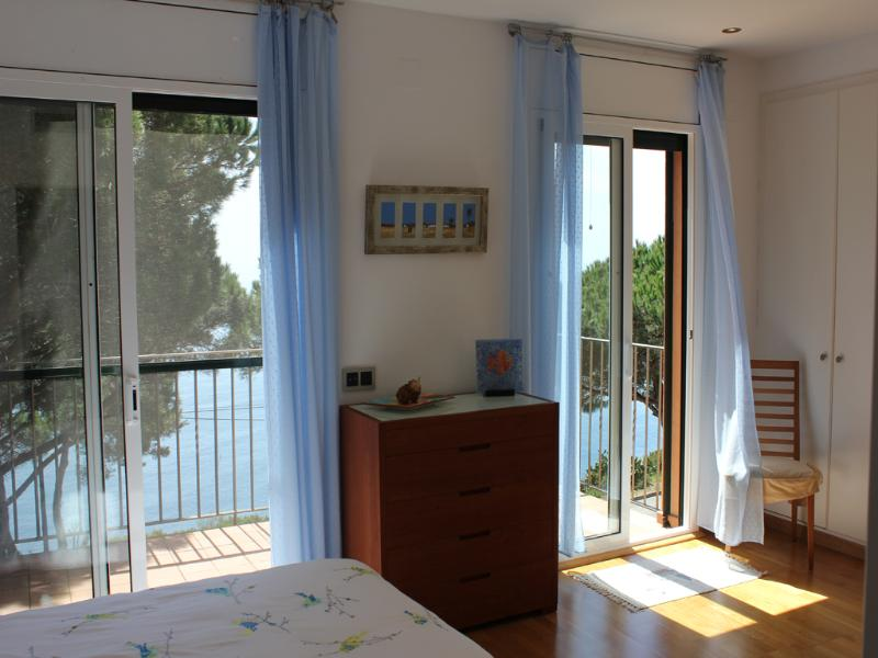 Spacious master bedroom overlooking the Mediterranean. Double balcony all to yourself.