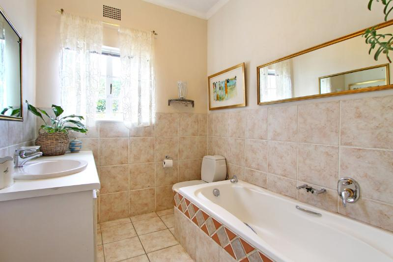 Family bathroom with hand held shower