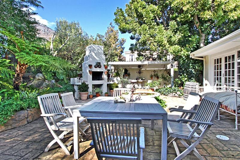 Sheltered leafy courtyard with mountain views perfect relaxing area.