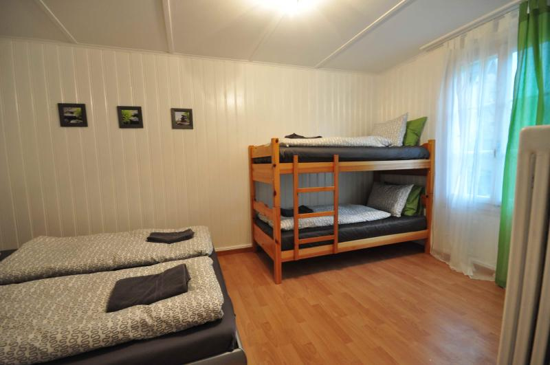 Quad room with adult size bunk beds and comfortable double