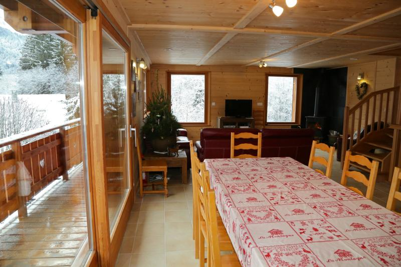 Dining room with extendible table seating 12, patio doors to balcony, views over mnt Evian