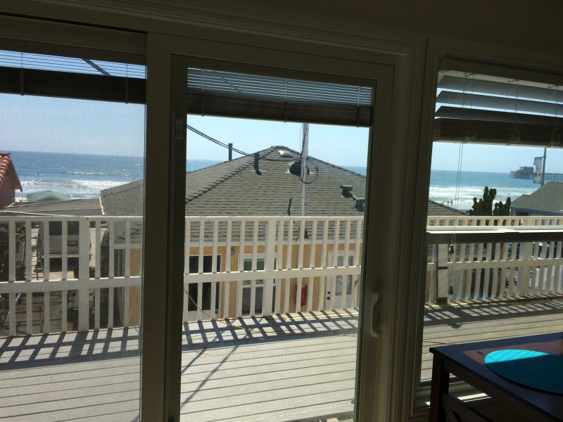 Unit is upstairs on the back building. Ocean views from living room and deck.