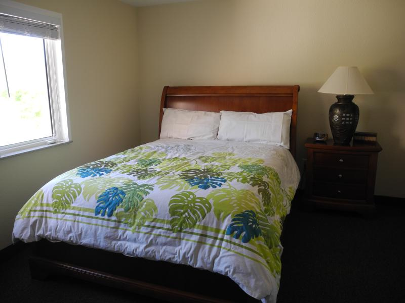 Second bedroom, QUEEN bed with full ensuite, rain head shower.  Beautiful views of ocean and bluff.