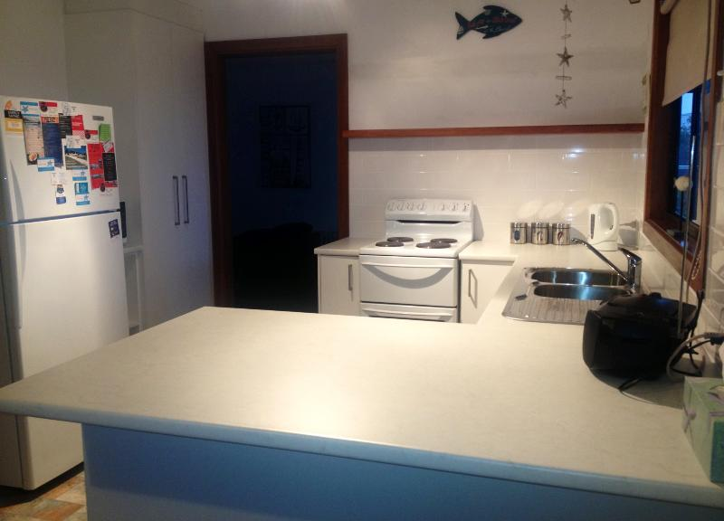 Newly renovated fully equipped kitchen with family size fridge/freezer, microwave & oven/stovetop