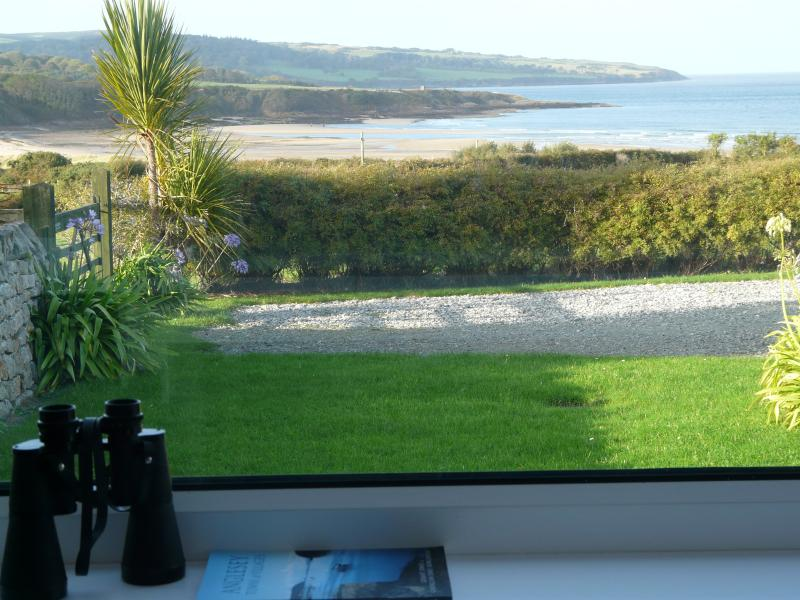 View of beach from dining room - tide on its way in