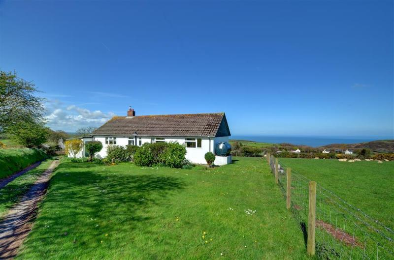 Arforwest is a detached bungalow near Llangrannog with a lovely outlook across fields to the sea