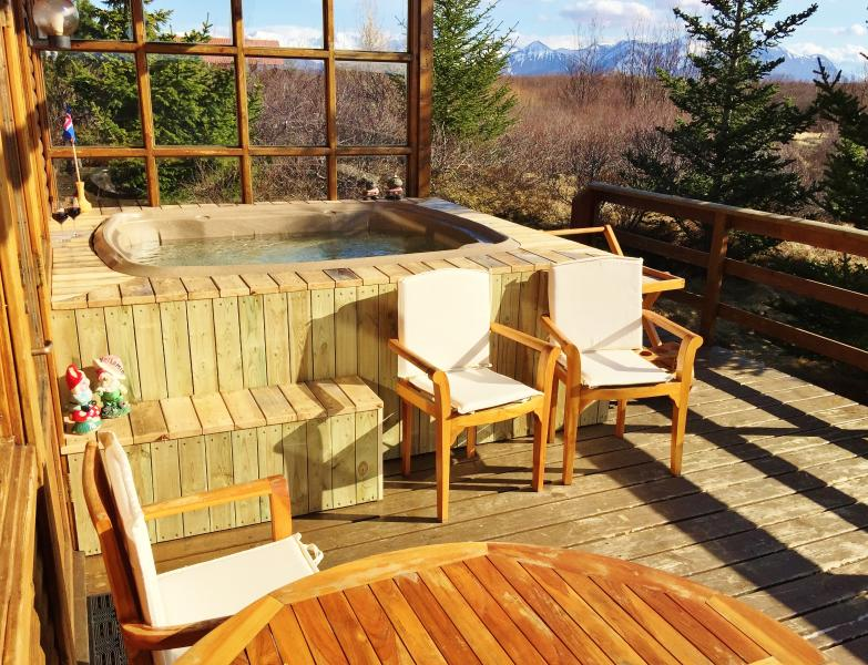 The HotTub on the porch with a mountain view to the South and North