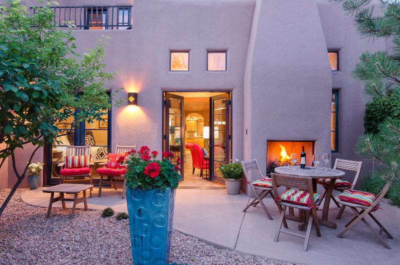 Outside fireplace and patio for a restful evening after a day exploring Santa Fe