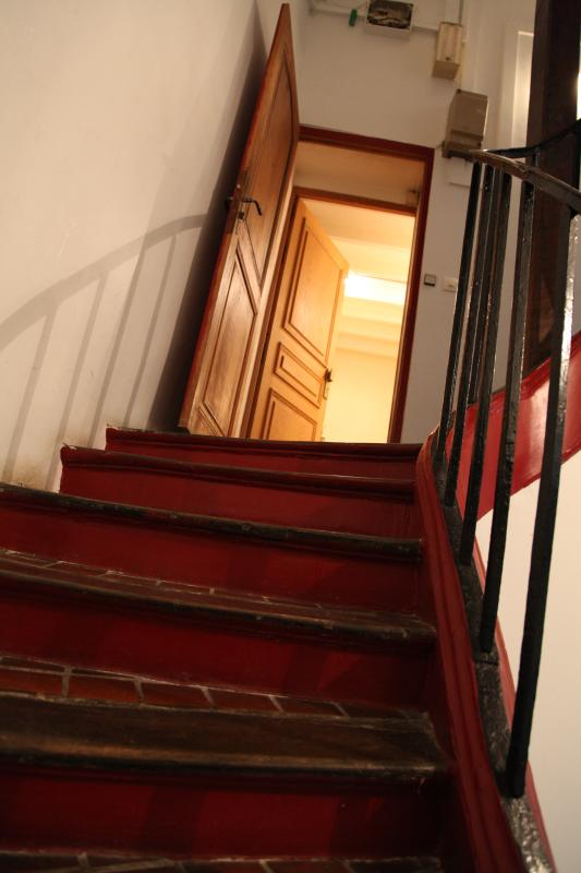 Hall; steps to the apartment
