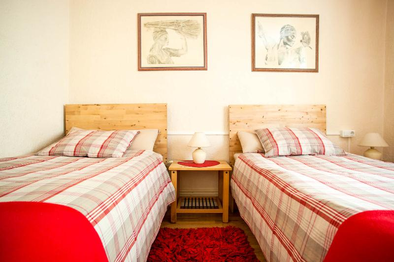 Twin beds in second bedroom can be put together for another couple. A third bed is available