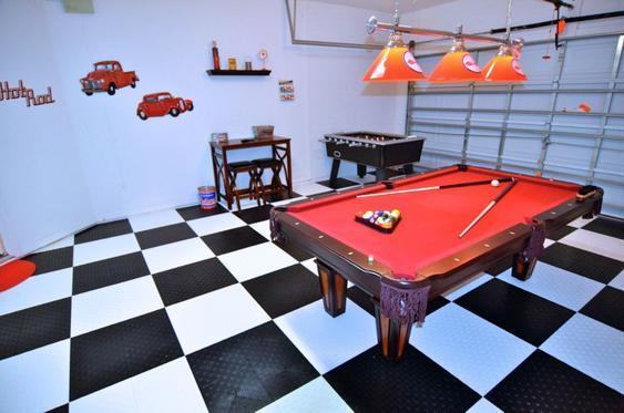 Fun vintage car themed games room with pool table, table football, seating and flat screen TV