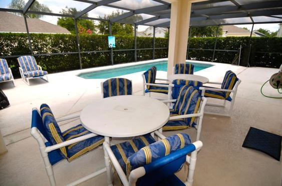 Pool deck with shaded dining area and sun loungers
