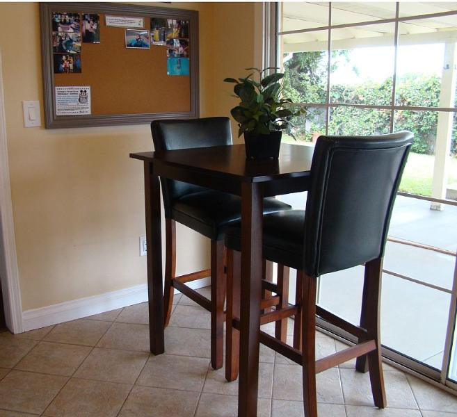 Additional eating pub table with bar stools in the kitchen.