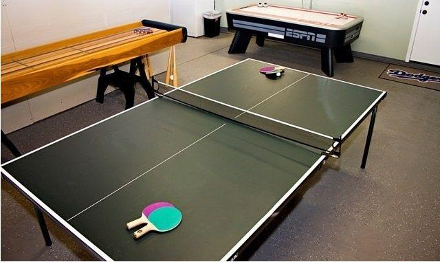 the Game room has a ping pong table, air hockey, shuffle board, darts and a TV.