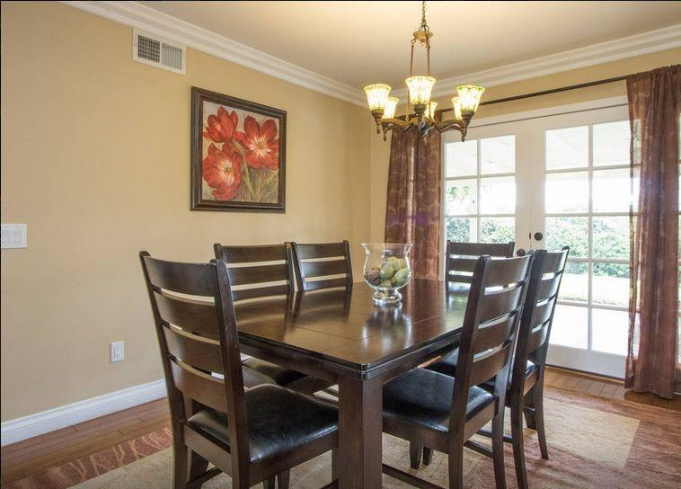 Dinning room with a view of the green backyard, city lights and direct access to the kitchen.
