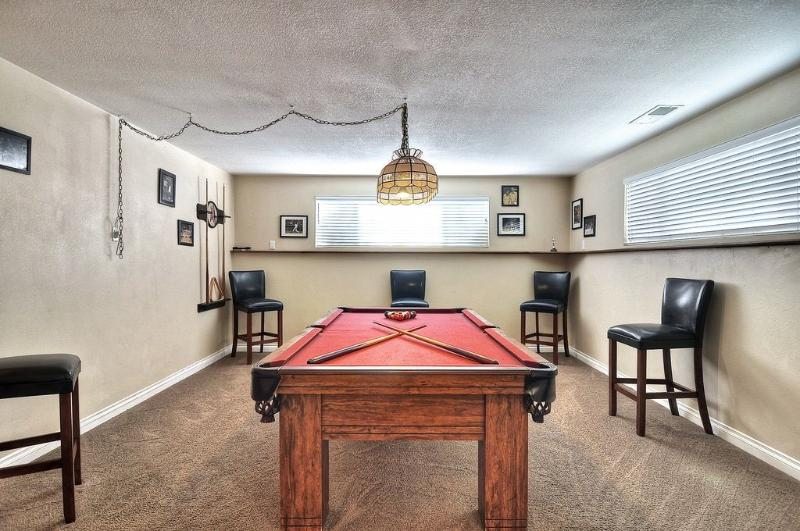 The basement game room has a billiard table, TV, DVD player and plenty of room for fun.