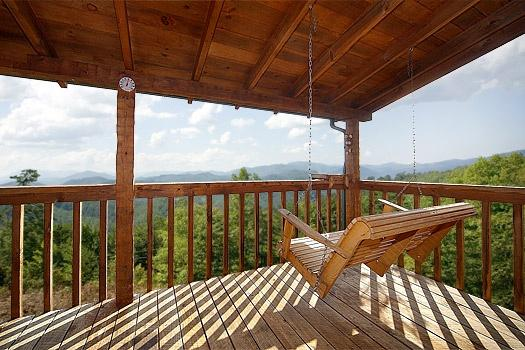 Covered Deck with Porch Swing at Sweet Serenity
